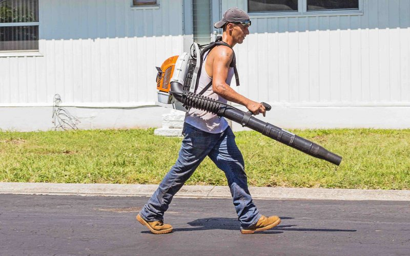Canva - Man in White Tank Top and Blue Denim Pants With Leaf Blower Outdoors during Daytime-compressed